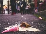 dropped ice cream cone melting on the street