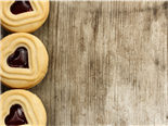 Shortbread cookies lined up on a wooden picnic table - Cookie consent concept