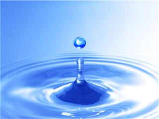 A water droplet splashing into blue water - Drip Marketing campaign concept