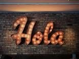 "neon sign reading ""Hola"""