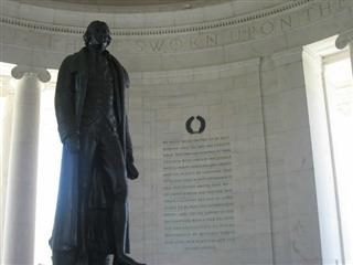 Statue of Thomas Jefferson in front of the United States Declaration of Independence.