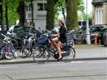 woman on bicycle with phone