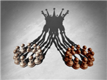Chess pawns forming a king crown cast shadow - Leadership concept