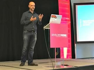 Bill Crowley CPO Hyperwallet on stage at DeveloperWeek