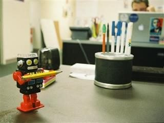 robot holding pencil