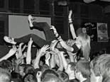 crowd surfing in a mosh pit