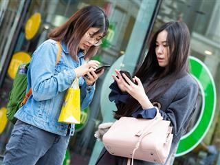 two women on cellphones