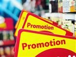 signs for promotion with out of focus store behind