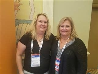 Photo of IT professionals Suzanne Tamayo (left) and Kari Brey at the Gartner Symposium/ITxpo in October.