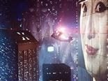 still frame from 1982's Blade Runner of a spinner flying by a billboard