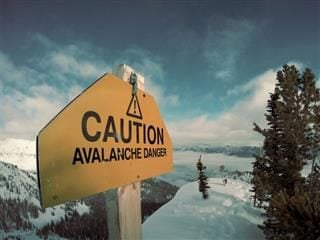 avalanche warning sign in the snow