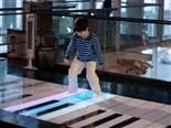 child playing with big piano