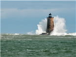 Giant waves cover the stone tower of Whaleback lighthouse in southern Maine