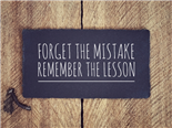 a sign that reads, forget the mistake, remember the lesson
