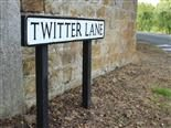 "sign that says ""twitter lane"""