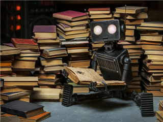 A robot reading amongst a great stack of books