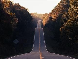 photo of a hilly road reaching into the distance