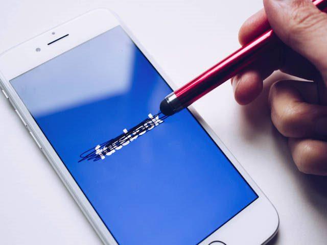 erasing the Facebook logo on a phone