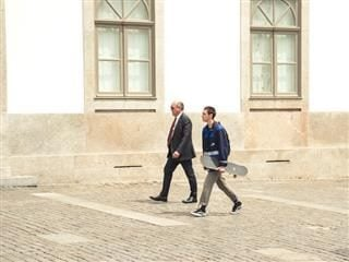 two generations walking down the street together