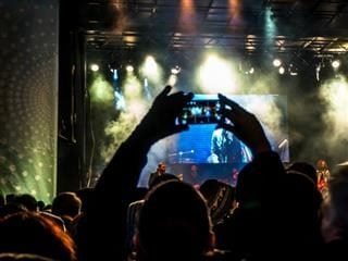 taking pictures at a concert