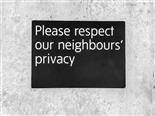 "sign reading ""please respect our neighbours' privacy"""