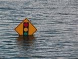 sinking stop sign with rising waters
