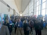 MarTech conference attendees walk through the vendor exhibition hall at the Hynes Convention Center.