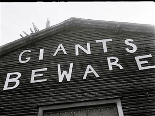 "House with a letters on it that says, ""Giants Beware"""