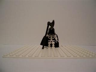 lego man dressed up like the Grim Reaper