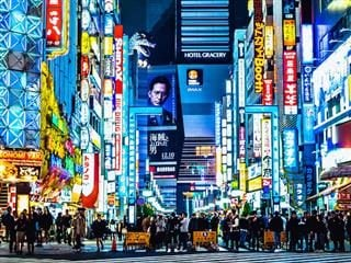 street scene in Tokyo with many neon signs