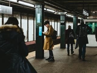 man on cellphone in subway station
