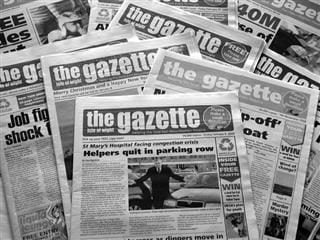stack of newspapers named the Gazette