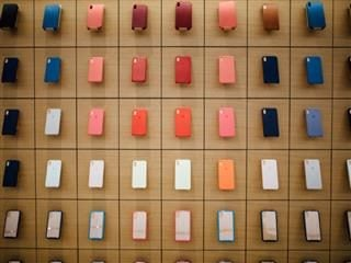 wall of mobile phones in multiple colors