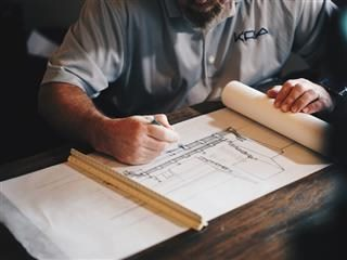 architect working on a drafting table