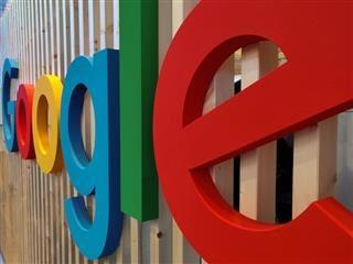 Google logo on fence