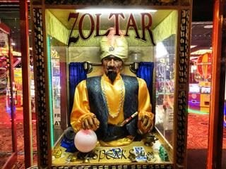 Zoltar fortune teller booth on a boardwalk