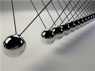business alignment concept - Al Newton's cradle on a white background