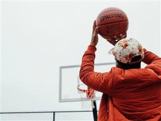 taking a shot in basketball