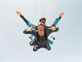 skydiving, two thumbs up