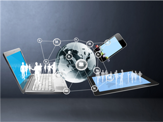 An abstract image with a globe, a laptop and a tablet, all of them interconnected - global technology concept