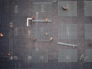 construction site, construction workers from above working in a grid pattern