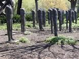a series of statues without heads