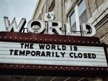 "The World cinema marquee with sign stating ""The World Is Temporarily Closed"""