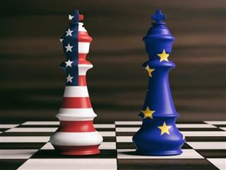 chess pieces on a board with US and European Union flag design