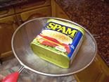 can of spam on a strainer