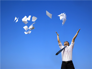 A man throwing documents in the air
