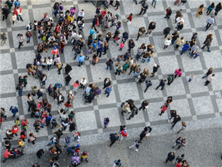 A crowd of people being viewed from a birds eye view.