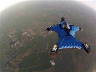 skydiver heading down to earth, photo taken from above