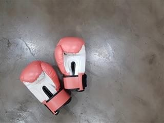 pair of boxing gloves on cement floor