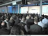 People listening to an Oracle executive at a past Demandbase company conference.